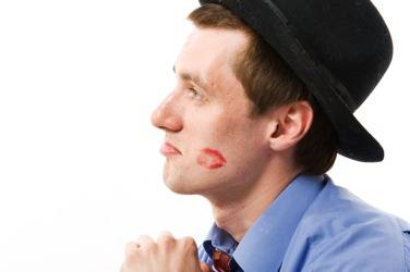 Man with lipstick  on his cheek
